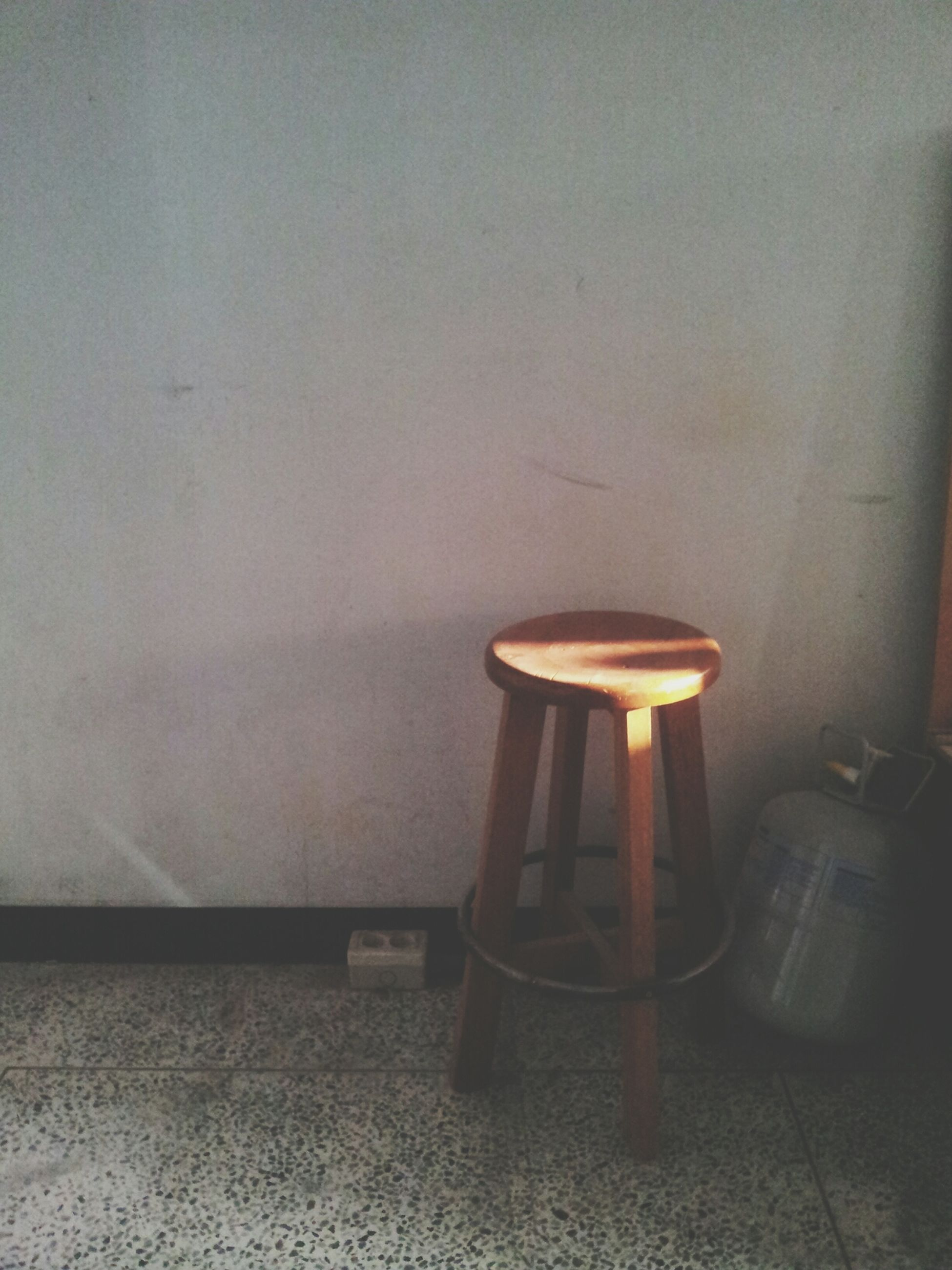 indoors, lighting equipment, illuminated, chair, wall - building feature, absence, architecture, home interior, built structure, table, electric lamp, empty, no people, lamp, wall, electric light, light - natural phenomenon, electricity, sunlight, still life