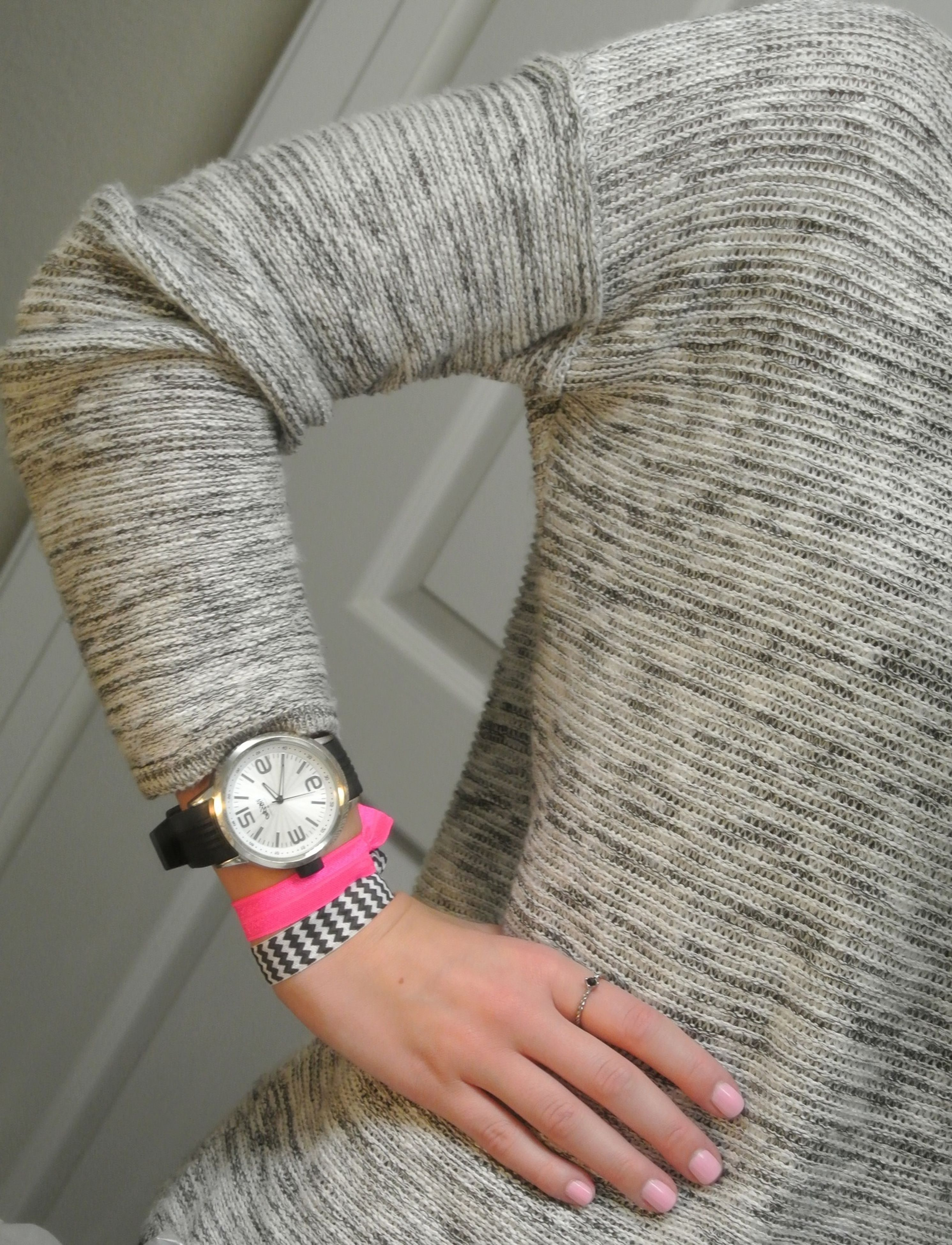 indoors, person, holding, part of, lifestyles, close-up, cropped, leisure activity, high angle view, human finger, fashion, unrecognizable person, wall - building feature, men, midsection, casual clothing