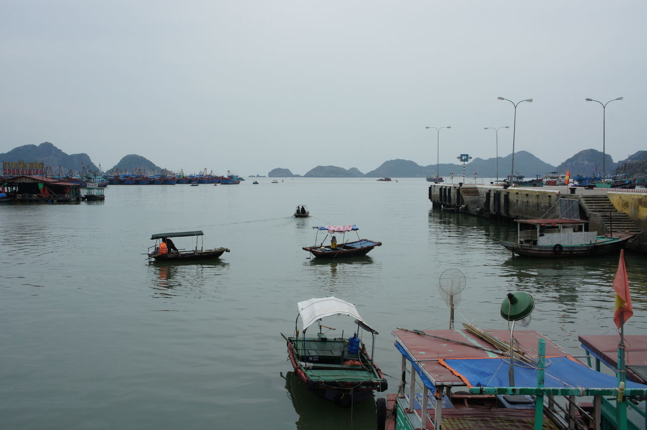 Astrology Sign Beauty In Nature Business Finance And Industry Day Ha Long Bay Halong Halong Bay Vietnam Halongbay HalongbayCruise Harbor Mode Of Transport Moored Mountain Nature Nautical Vessel No People Outdoors Pedal Boat Sky Transportation Travel Destinations Water