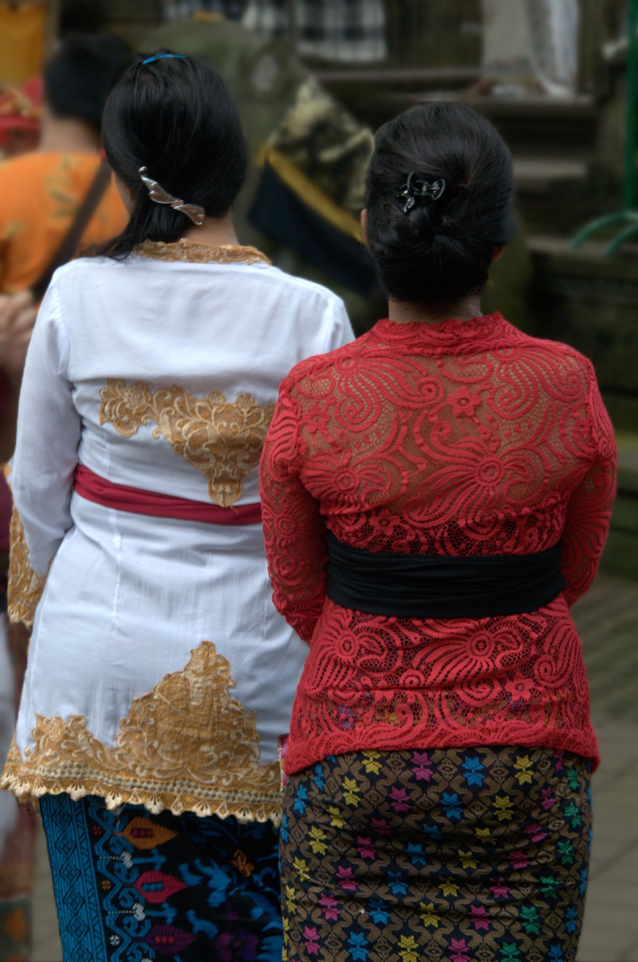 Balinese Women In Ceremonial Costume Ceremony Religious Ceremonies Ceremonial Costumes Balinese Culture People Two Women Spirituality Praying Hinduism Tradition ASIA Religion Vertical Outdoors Rear View Hindu Temple Colour Image