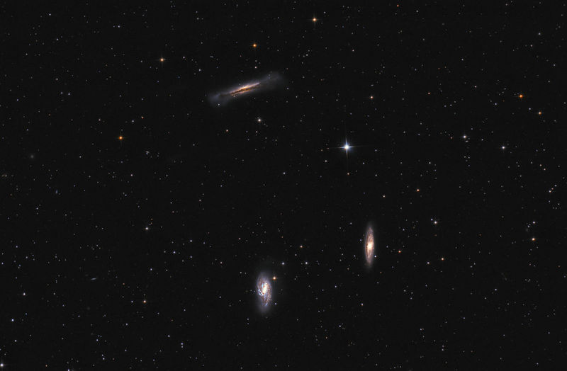 The Leo Triplet galaxies (also known as M66 Group). It is a small group of galaxies about 35 million light-years away from Earth, in the constellation Leo. This galaxy group consists of three spiral galaxies: M65, M66, and NGC 3628. Picture taken with newton telescope 750mm focal length and astronomic camera. Total exposure time: 5 hours 10 minutes. Astrology Astronomy Astrophotography Black Constellation Cosmic Cosmos Deep Space Galaxies Galaxy Hamburger Galaxy Leo Leo Triplet M65 M66 Night Night Sky Science Science Sky Space Exploration Starfield Starry Night Stars Universe