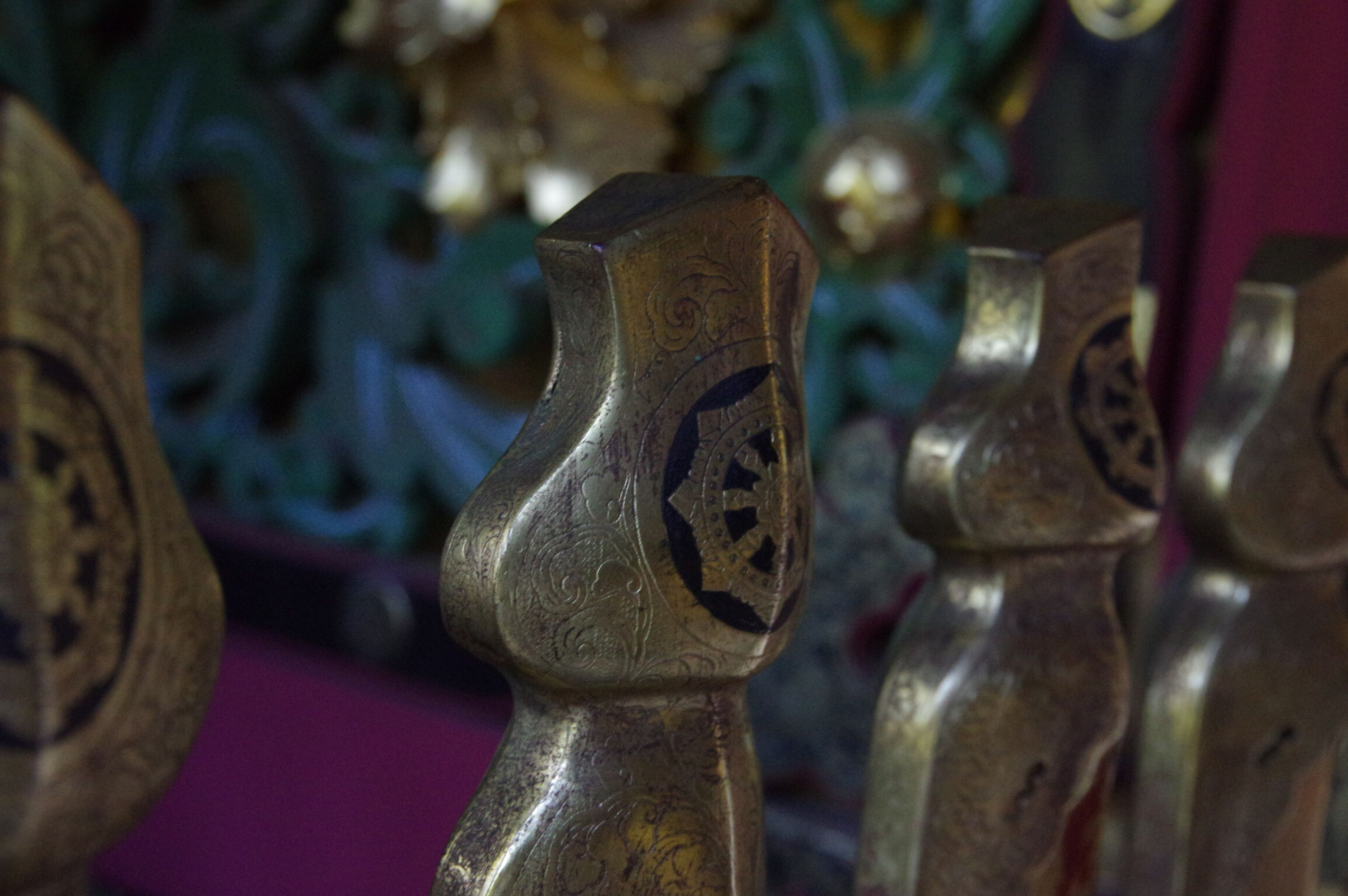 focus on foreground, close-up, metal, art and craft, indoors, religion, art, spirituality, selective focus, creativity, old, metallic, human representation, sculpture, antique, statue, no people, ornate, still life, carving - craft product