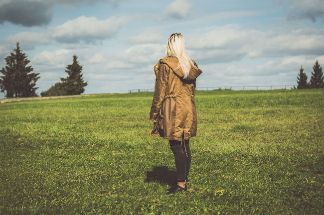 Adult Adults Only Agriculture Beauty In Nature Cloud - Sky Day Field Full Length Grass Landscape Nature One Person One Woman Only One Young Woman Only Only Women Outdoors People Rear View Rural Scene Scarecrow Sky Traditional Clothing Tree Young Adult
