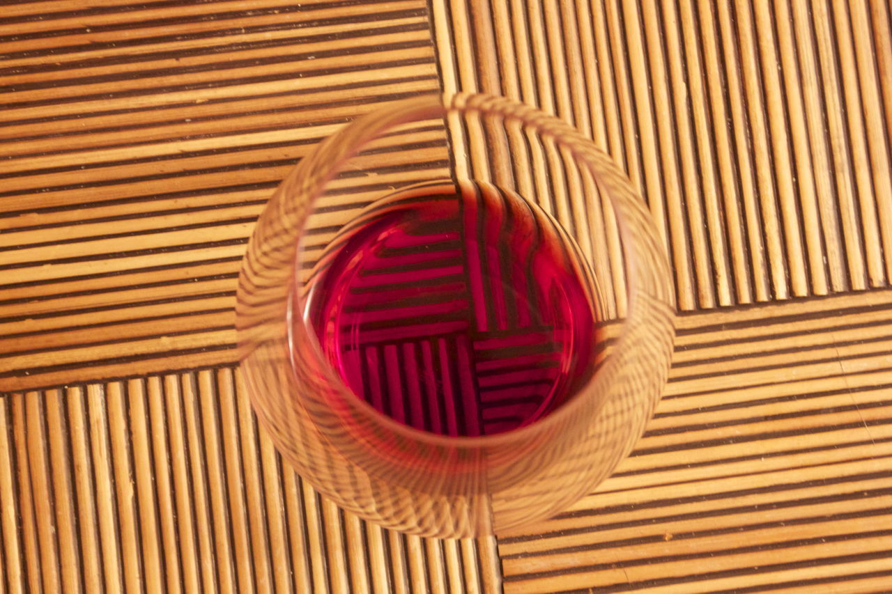 Directly Above Shot Of Red Wineglass On Table