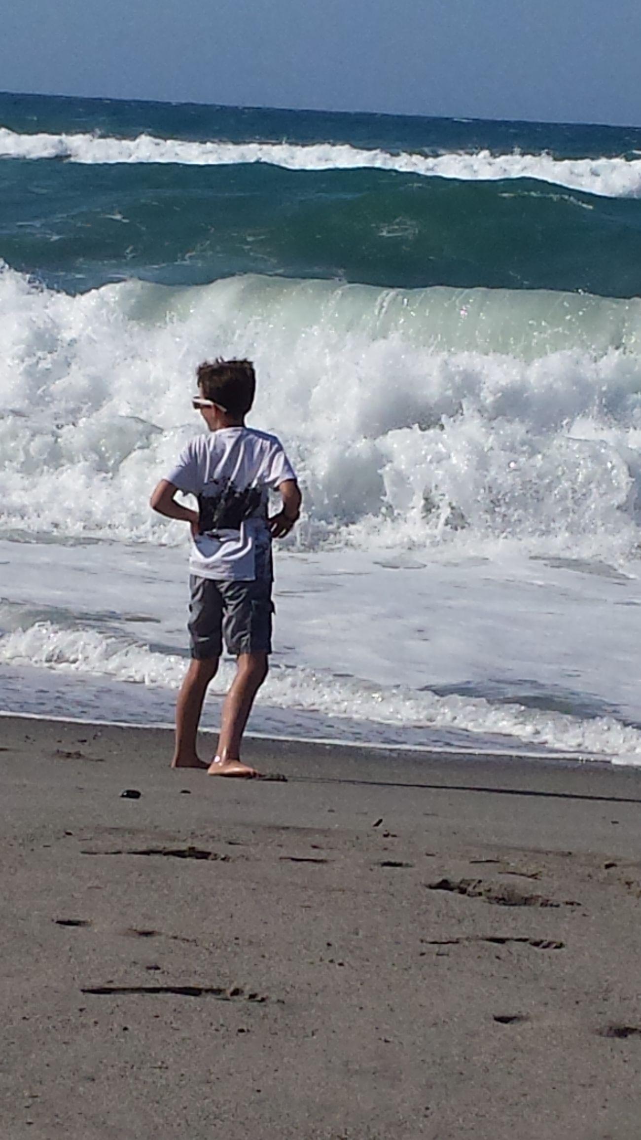 Waves and boys Platanias Crete Greece