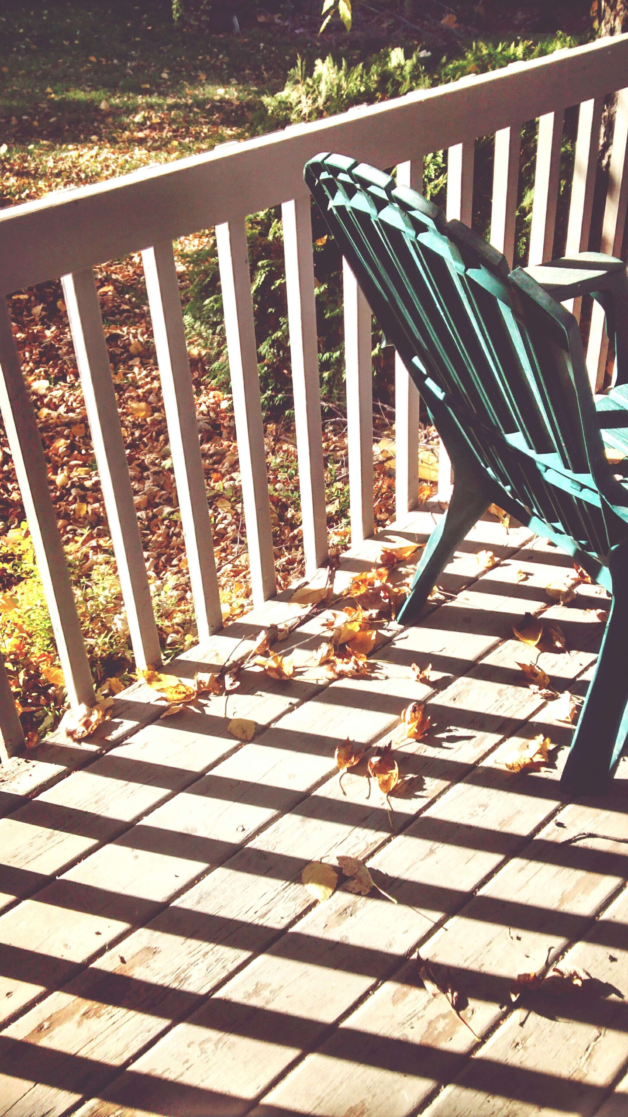railing, shadow, sunlight, built structure, high angle view, steps, wood - material, empty, pattern, steps and staircases, the way forward, architecture, staircase, park - man made space, no people, day, in a row, walkway, metal, outdoors