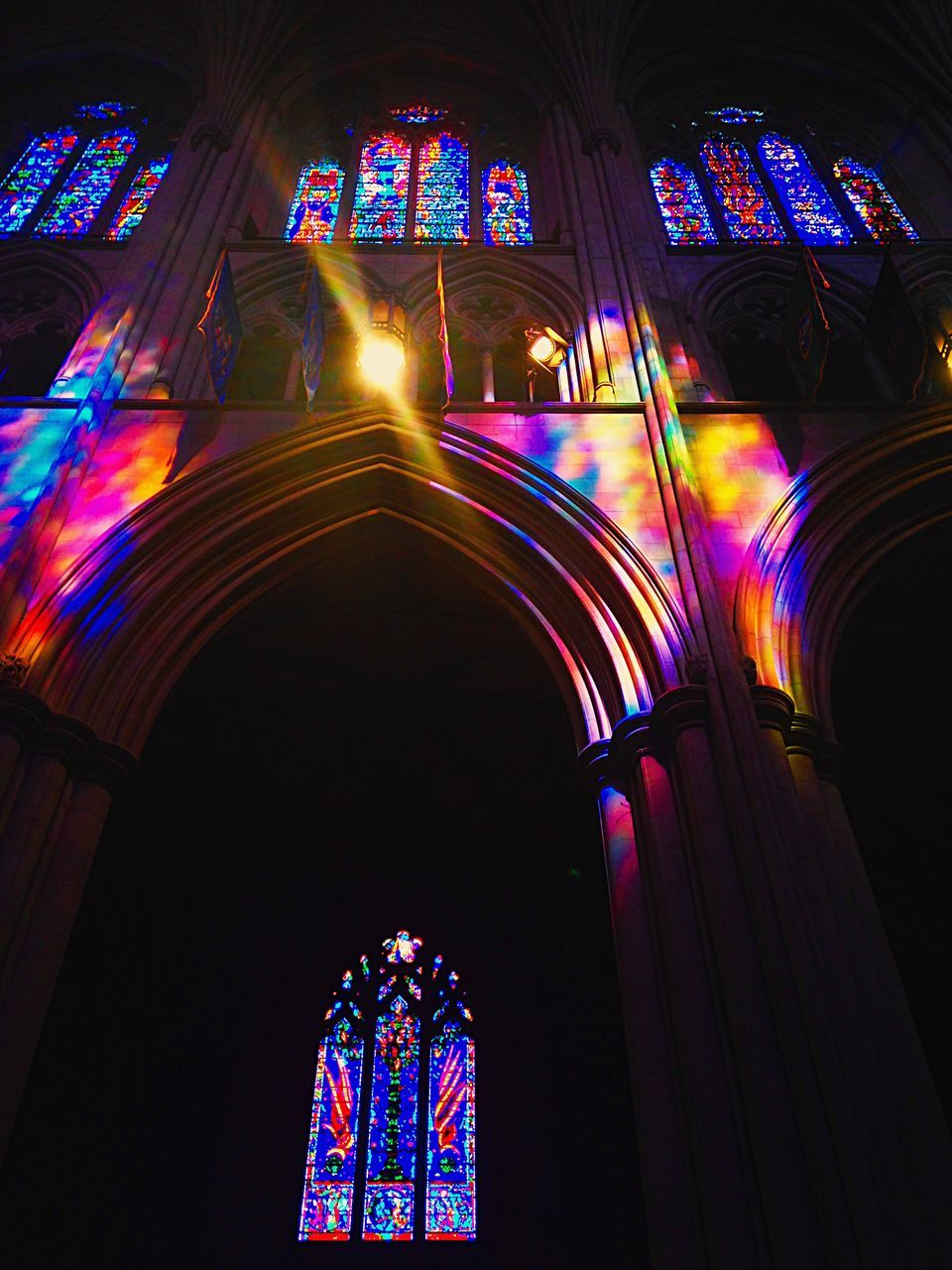 multi colored, indoors, low angle view, place of worship, window, no people, religion, illuminated, architecture, day