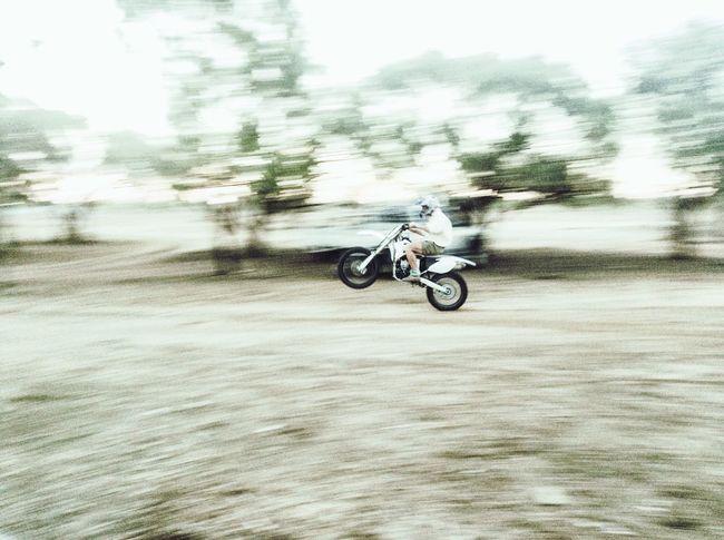 Capturing Motion Outdoors Motorbike, Dirt Bike, Motorcycle, Motocross, Wheelie, Fast, Speed, Motion, Rural,ride, Wheels, Riding Adventure Blurred Motion Crash Helmet Transportation Motion Helmet Motorsport Biker Sports Race