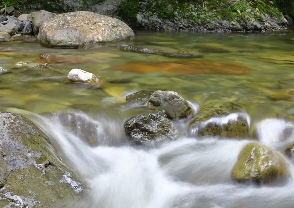 A time lapse capture of a slow flowing stream. Beauty In Nature Fresh Water Outdoors Rocks Rocks And Water Rocks In Water Serene Outdoors Serenity Stream Time Lapse Time Lapse Photography Tranquility Water Wet Stones
