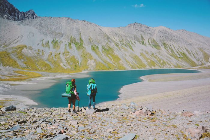 Hiking Lifestyle Trekking Adventure Alpine Landscape Beauty In Nature Day Full Length Kelitsadi Lake Lake Landscape Leisure Activity Lifestyles Men Mountain Nature Outdoors People Real People Scenics Sky Standing Two People Two Woman Women