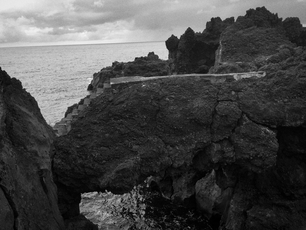 Sea Rock - Object Rock Formation Nature Water Beauty In Nature Scenics Cliff Tranquility No People Tranquil Scene Landscape_photography Black & White Black And White Black&white Azores Pico Sky Day Horizon Over Water Architecture