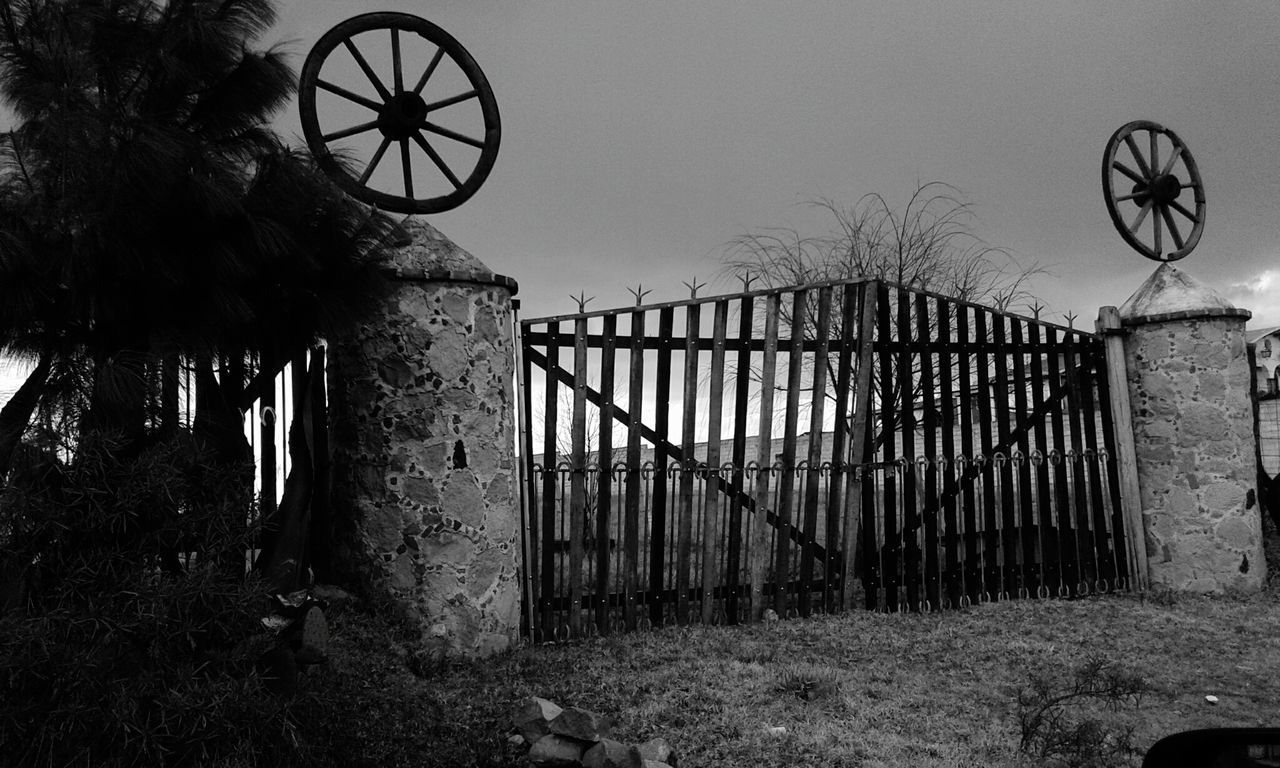Old Gate With Wheels As Decoration
