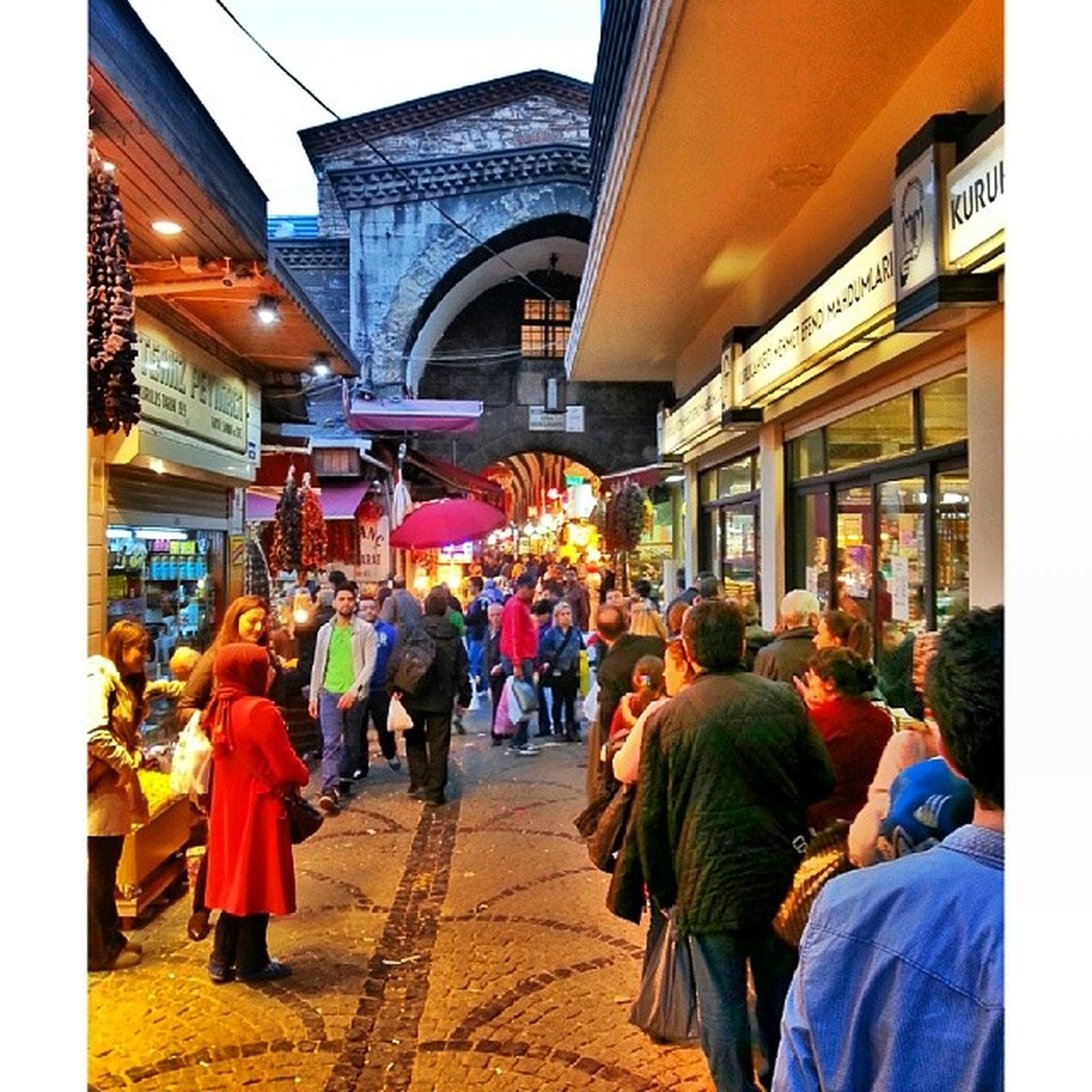 architecture, building exterior, built structure, men, person, large group of people, lifestyles, walking, city, street, city life, leisure activity, market, mixed age range, outdoors, rear view, market stall, building, medium group of people