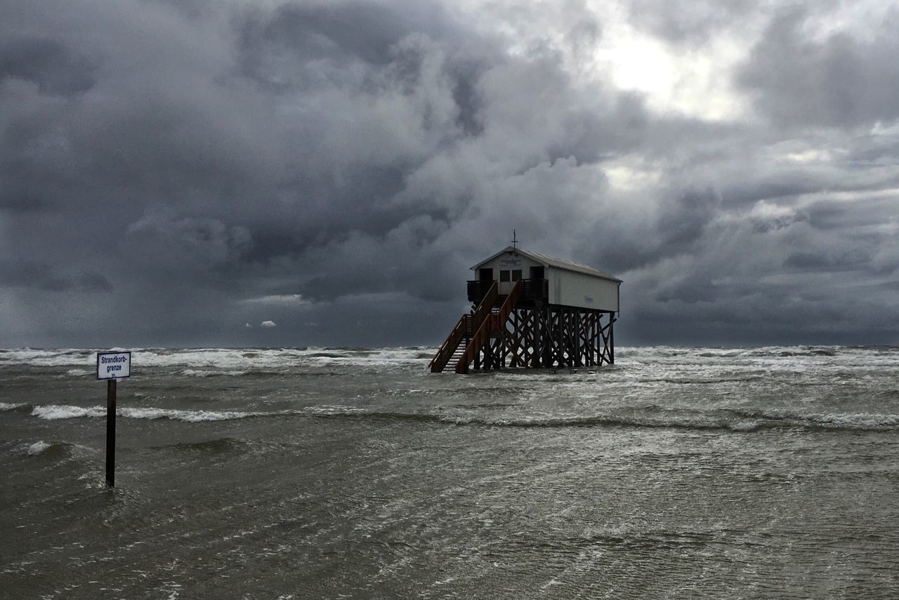 Lifeguard Hut On Beach Against Storm Clouds
