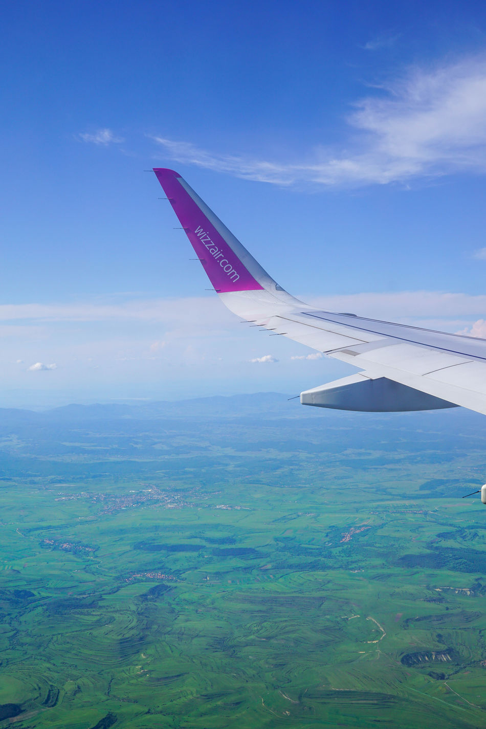 Aerial View Aerospace Industry Air Vehicle Aircraft Wing Airplane Business Finance And Industry Cloud - Sky Commercial Airplane Day Flying Landscape Mid-air Modern Mountain Nature No People Outdoors Sea Sky Transportation Travel Wizz Wizzair