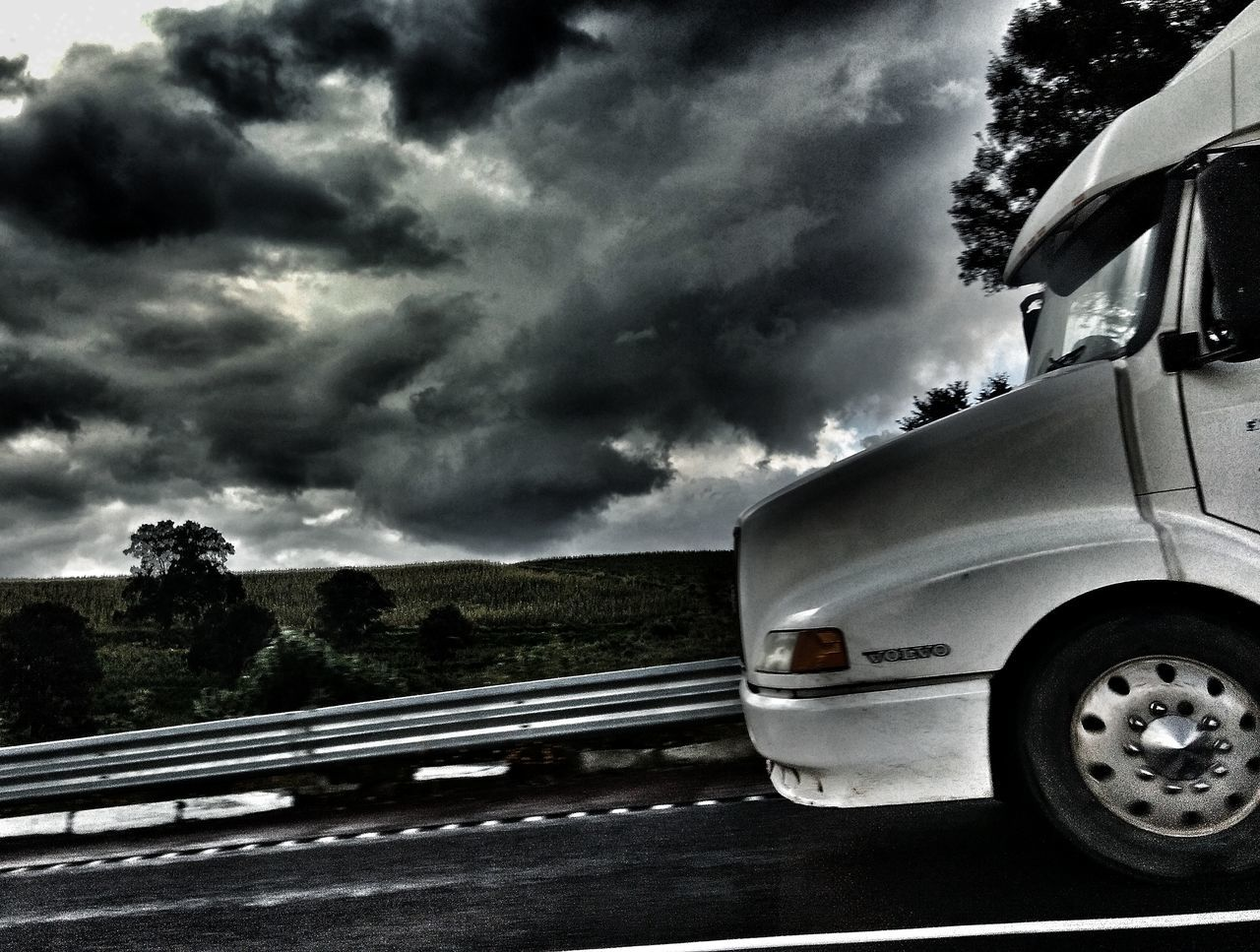 Truck Transportation Road Built Structure Architecture Sky Outdoors Day Cloud - Sky Vehicle Storm Cloud No People Streetphotography Scenics Landscape Morning Light Exterior Ligth And Shadows Dark Filmphotography Talking Photo Road Roadtrip My Point Of View Fast