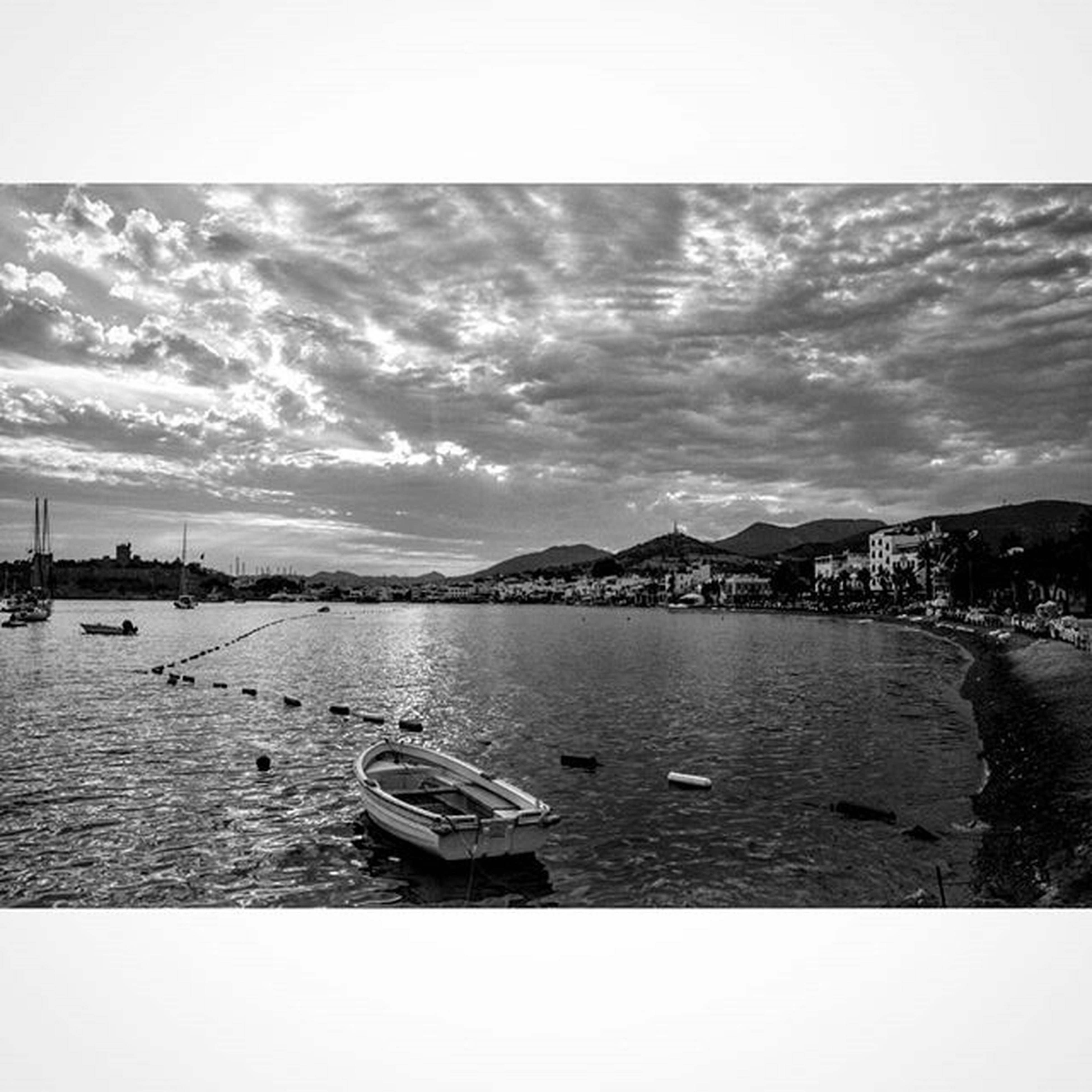 water, sky, transfer print, transportation, nautical vessel, mode of transport, auto post production filter, river, sea, tranquility, boat, moored, tranquil scene, lake, nature, scenics, cloud - sky, built structure, day, pier