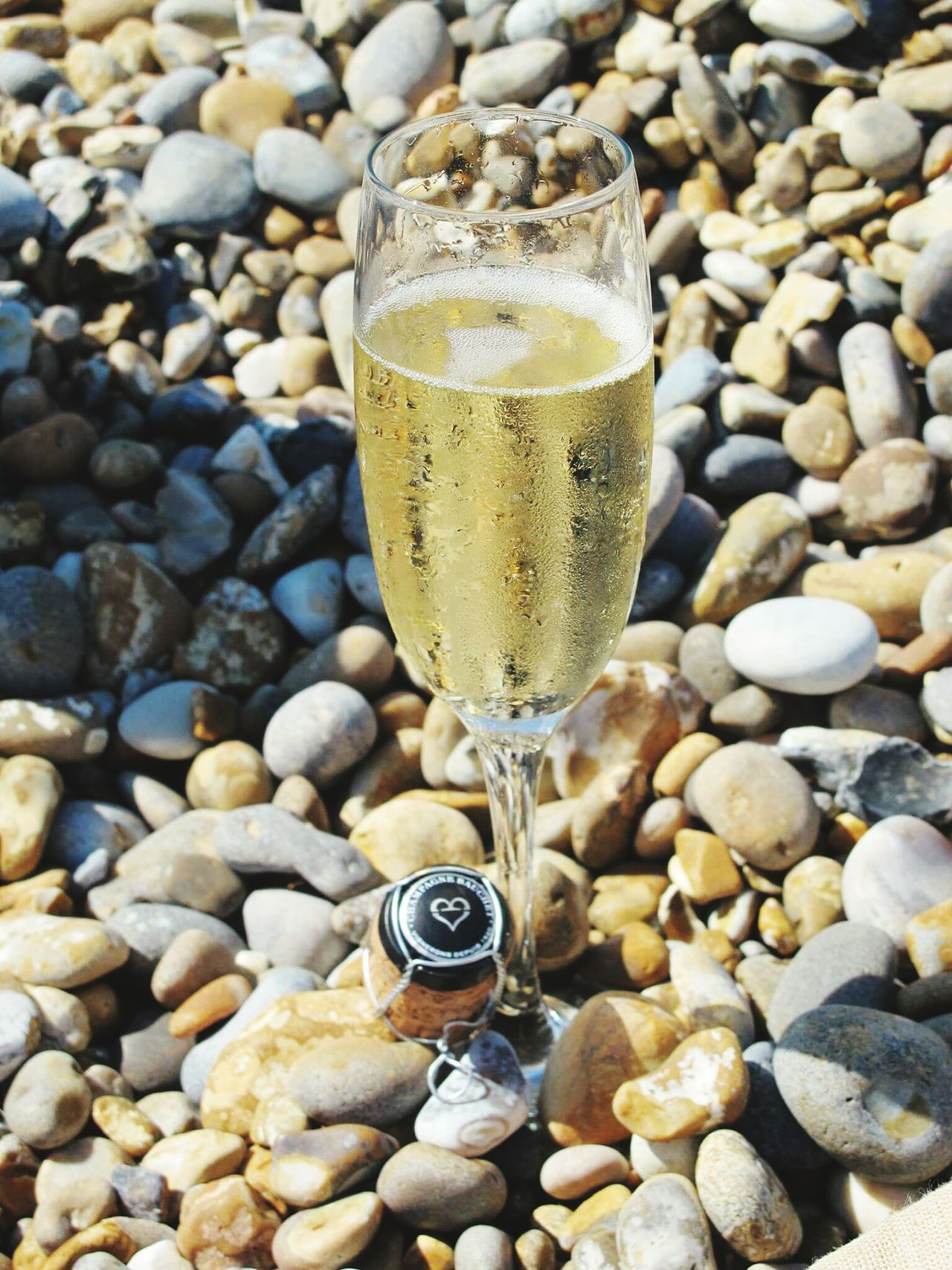 Champagne On Beach Champagne Champagne Flute Pebbles On A Beach Celebrate