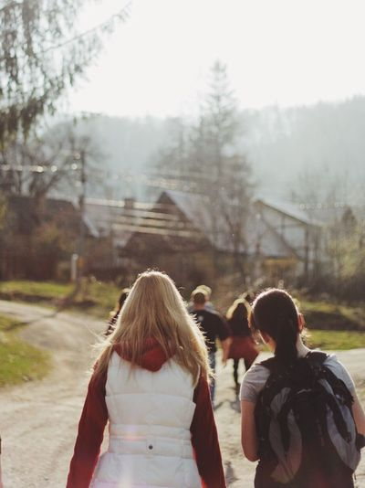 Real People Rear View Togetherness Hiking Girls Leisure Activity Lifestyles Friendship Day Road Outdoors Hike On The Road Outside Spring Focus On Foreground Backside Portrait Back Blonde Girl Blonde Women Bonding Nature Adult People