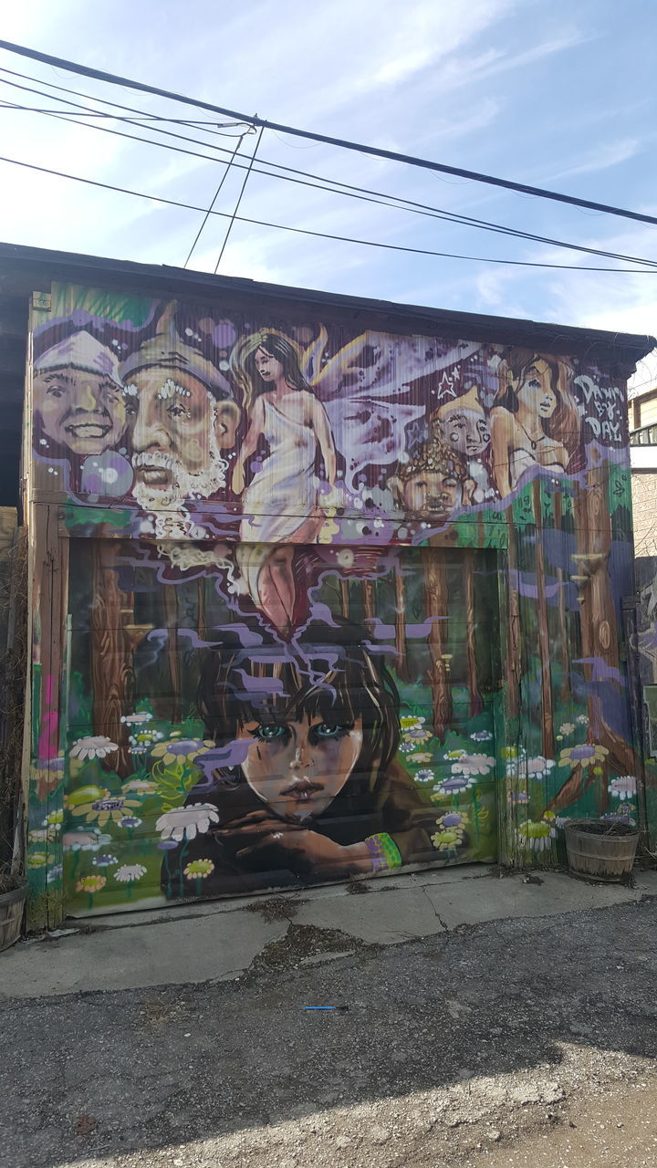 art and craft, creativity, human representation, graffiti, outdoors, day, built structure, architecture, multi colored, building exterior, no people, statue, sky