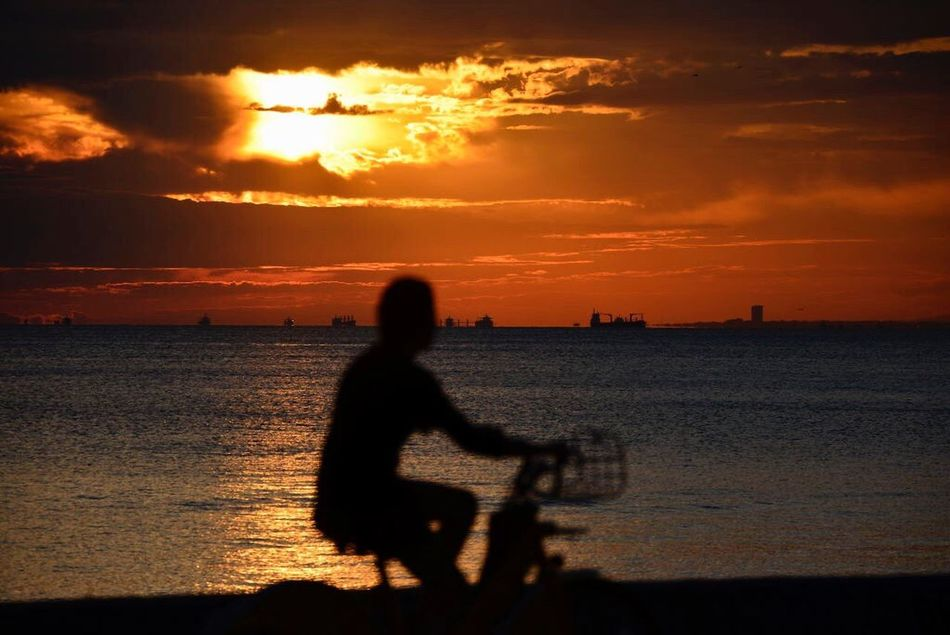 EyeEmNewHere Sunset Beach Silhouette Real People Sunlight Lifestyles Cloud - Sky Sky Sea Voyage Cycling Healthy Lifestyle Bisiklet Istanbul Turkey Bostancı