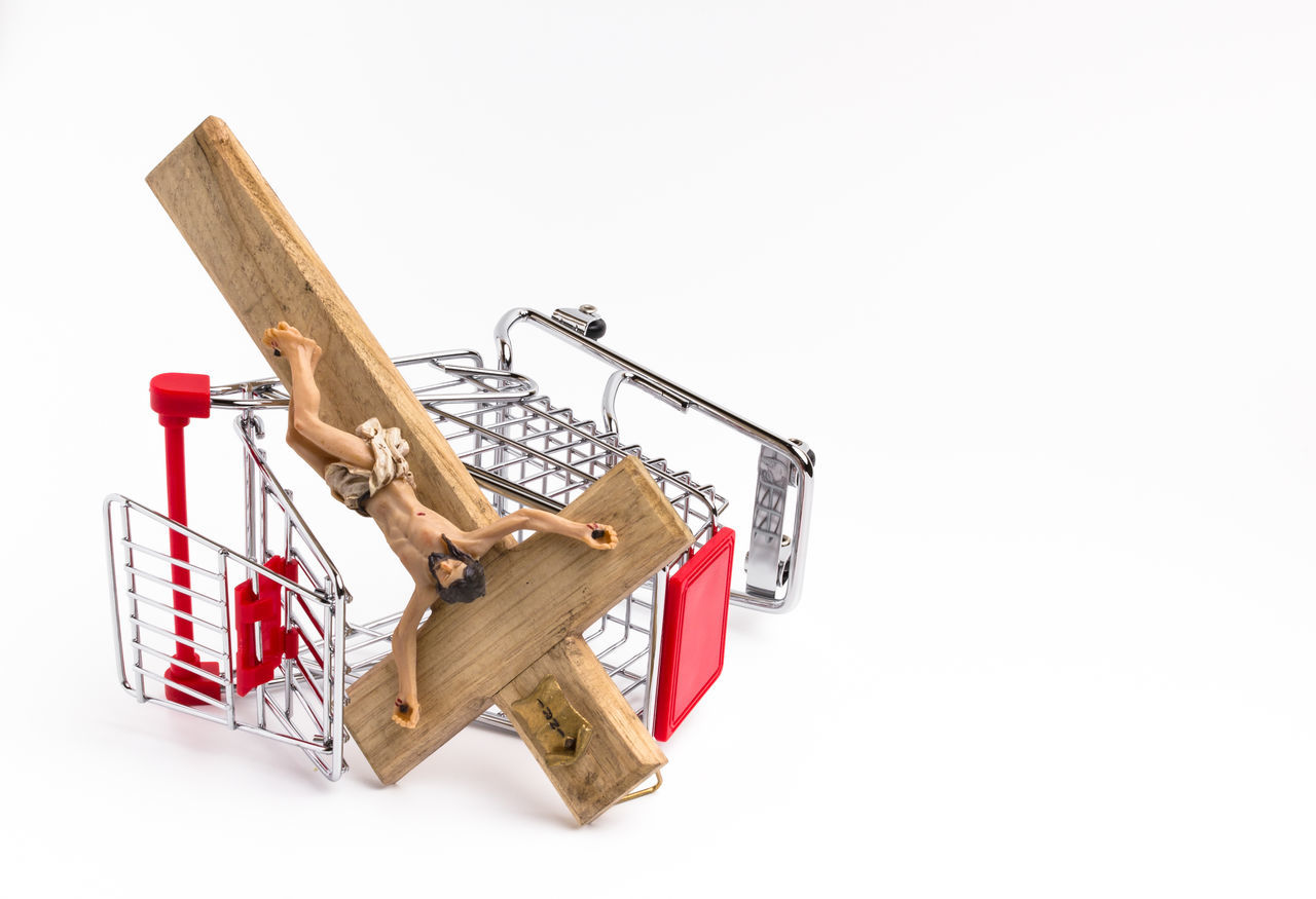 shopping cart overturned with crucifix on the ground. Conceptual representation of commodification of religion, loss of faith, blasphemy. Blasphemy Business Buy Carry Cart Catholic Christian Christianity Church Collapse Concept Consumer Crisis Cross Crucifix Easter Evil Faith Fall Falling God Isolated Jesus Loss Market