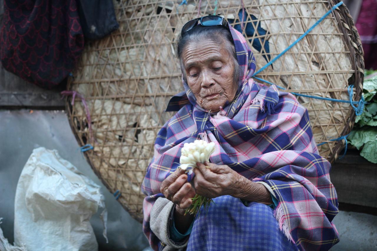 Faces Of Meghalaya #barabazaa #candid Portrait #facesofmeghalaya #India #khasipeople #market #meghalaya #potraits #potraitsofwomen #shillong #Vegetableseller First Eyeem Photo