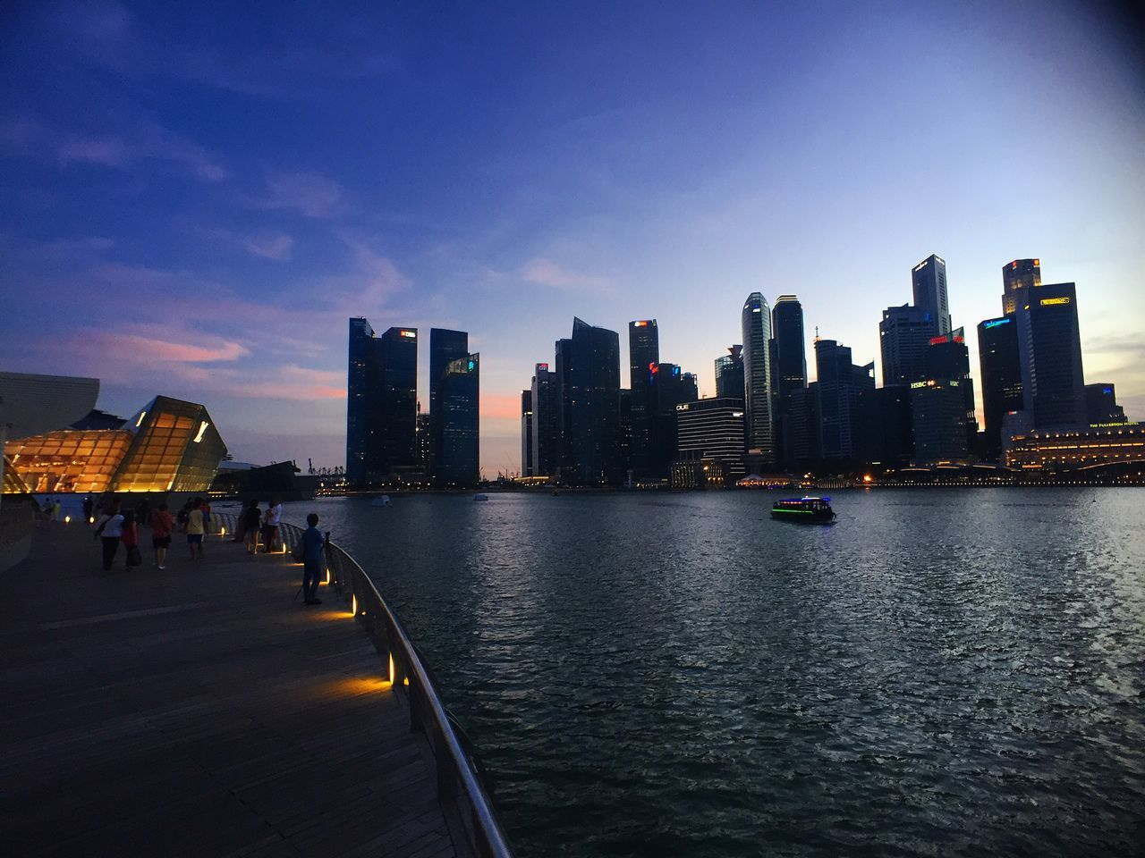 architecture, building exterior, built structure, skyscraper, city, water, sky, modern, urban skyline, cityscape, travel destinations, city life, outdoors, sea, illuminated, no people, day