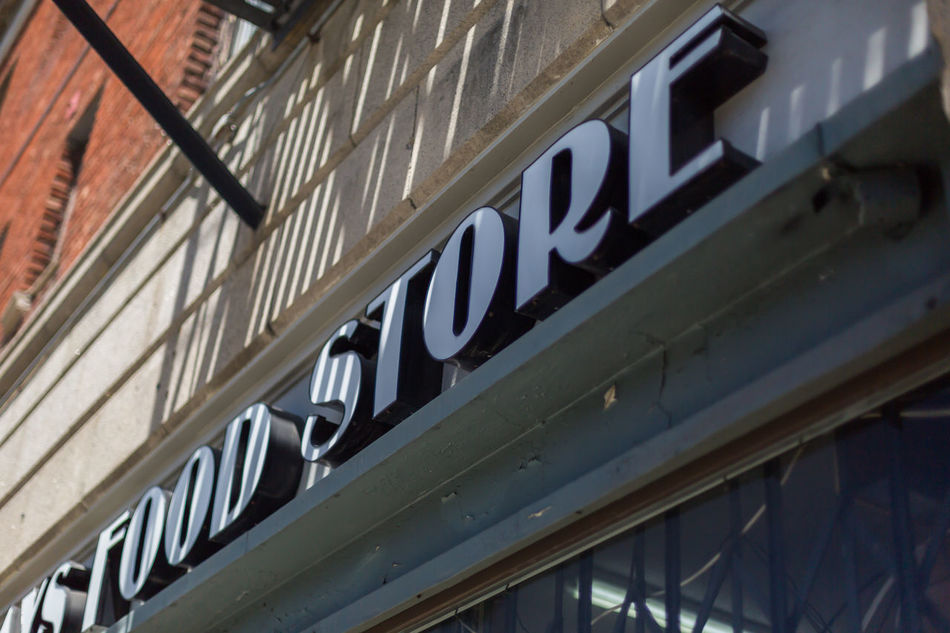 Food store Architecture Architecture Building Building Exterior Building Facade Building Front Built Structure Close-up Day Food Store Sign Low Angle View No People Outdoors Shaded Shadows Signage Store Front Text Windows