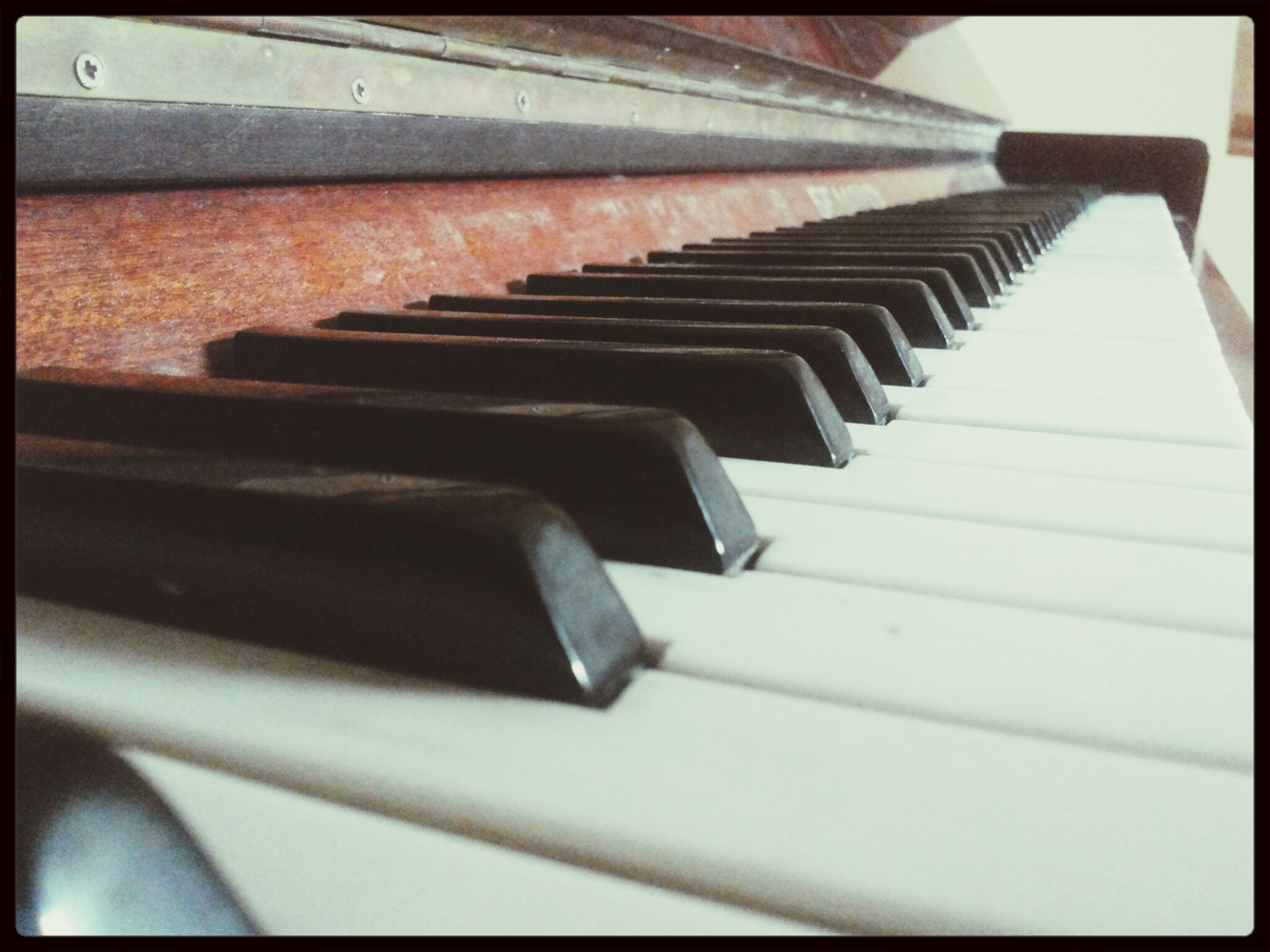 indoors, transfer print, piano, piano key, musical instrument, music, auto post production filter, close-up, arts culture and entertainment, in a row, steps, wood - material, high angle view, steps and staircases, staircase, musical equipment, no people, selective focus, railing, part of