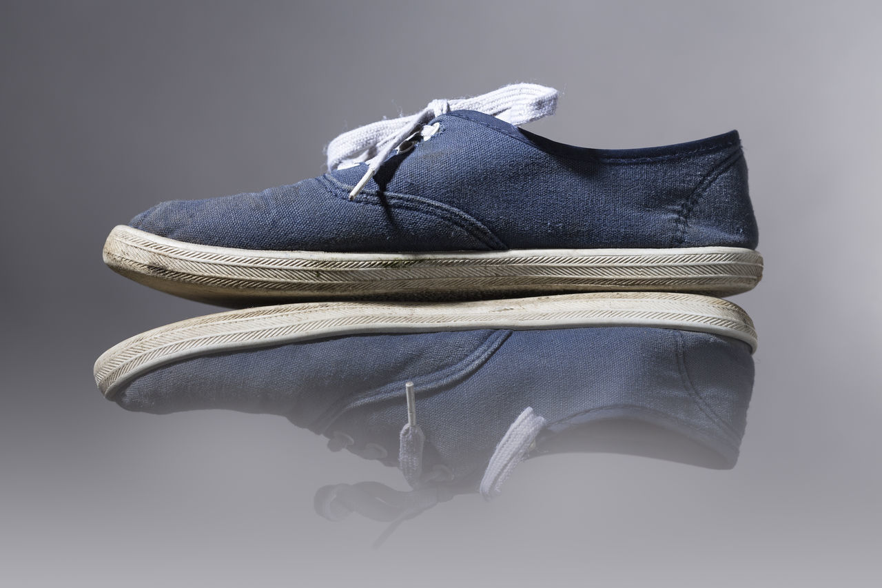 Blue Canvas Close-up Fashion Gray Background Grunge Lifestyles Mirroring Old Pair Presentation Scuffed Shoe Sneakers Sport Studio Shot Unusual Use Worn