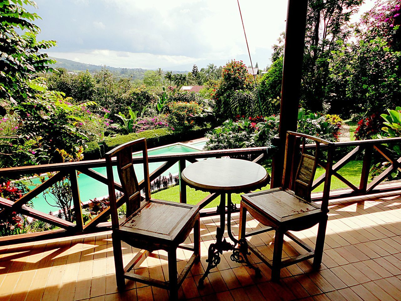 Puncak Pass INDONESIA patio balcony overlooking swimmingpool Jawa
