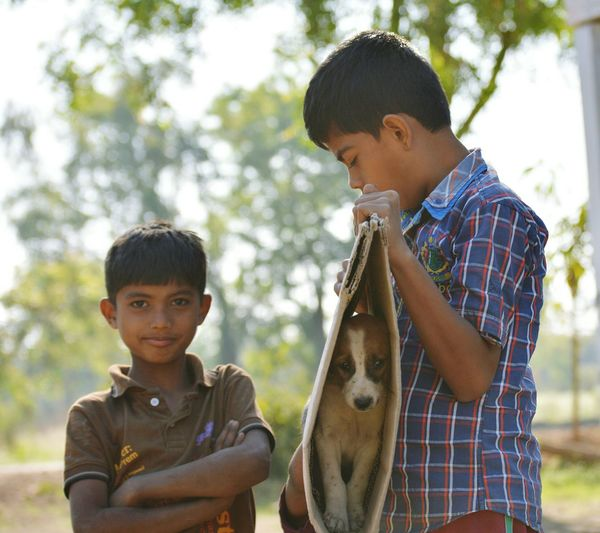 Boys Child Males  Childhood One Animal Looking At Camera Portrait People Family Son Bonding Rural Scene Puppy Cutness