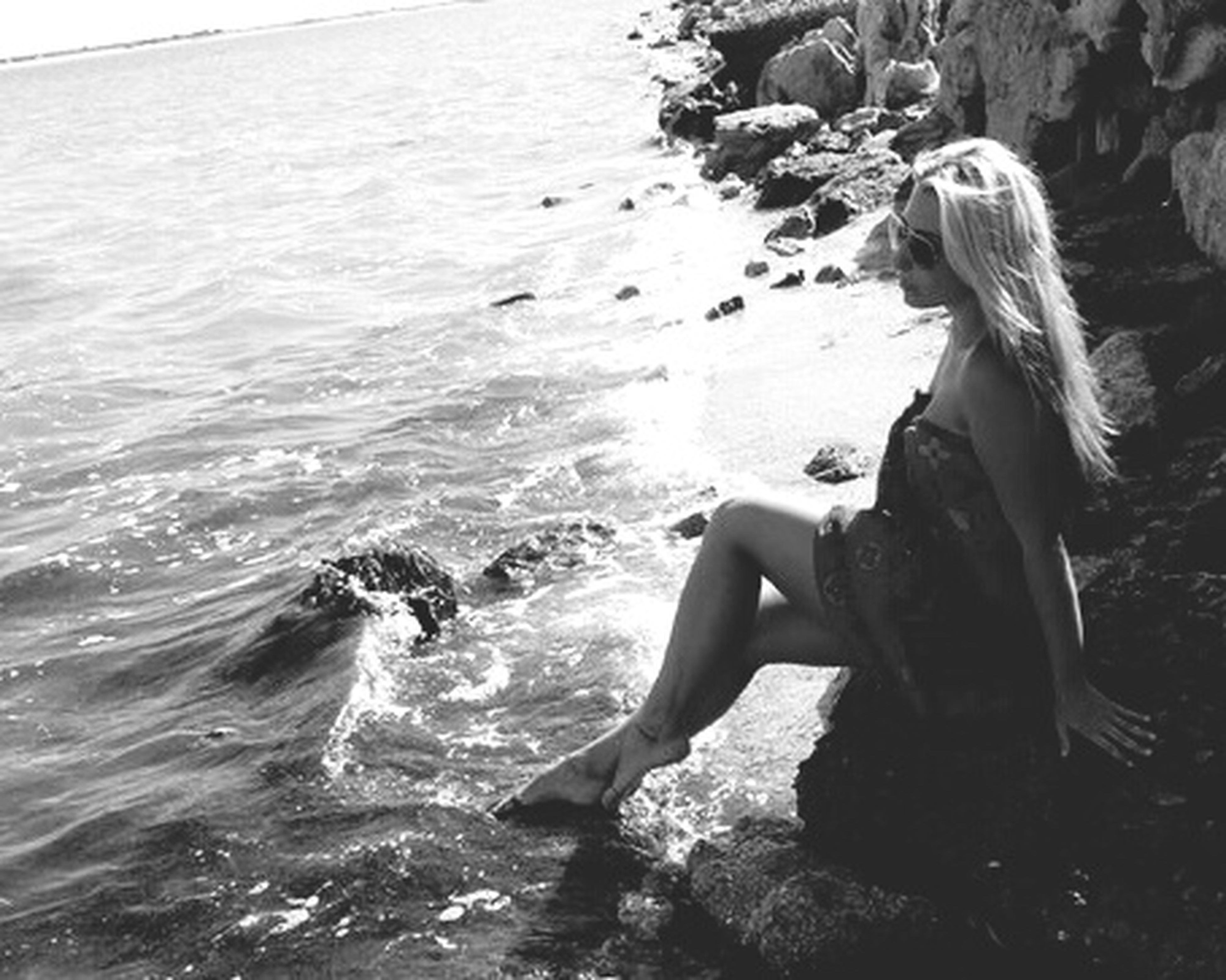 water, lifestyles, leisure activity, sea, young adult, young women, full length, waterfront, nature, person, rock - object, rippled, vacations, shirtless, sunlight, side view, three quarter length, standing