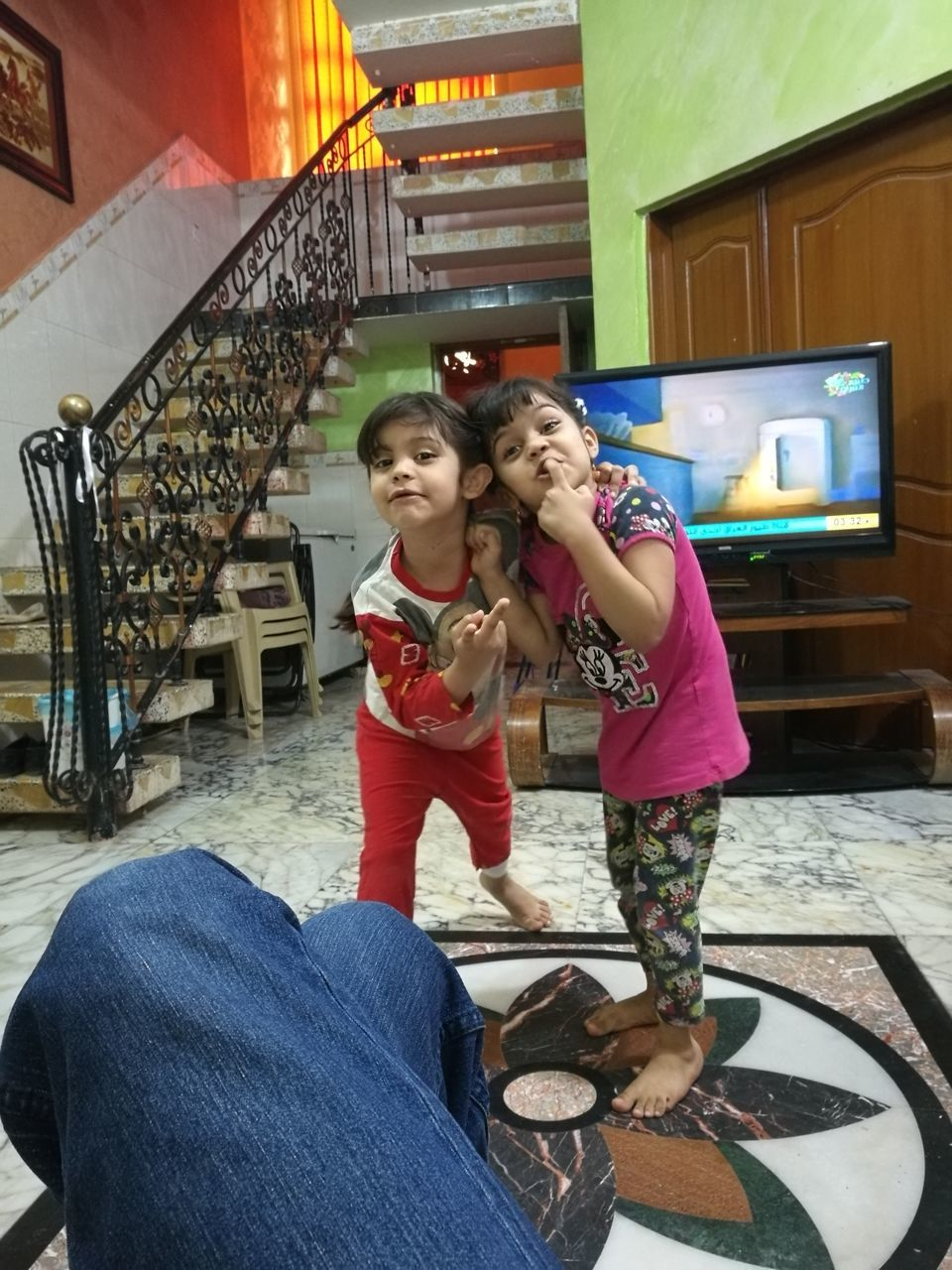 togetherness, casual clothing, real people, childhood, leisure activity, mother, elementary age, bonding, love, lifestyles, girls, standing, family with one child, daughter, indoors, boys, full length, holding, technology, sitting, day, young women, young adult