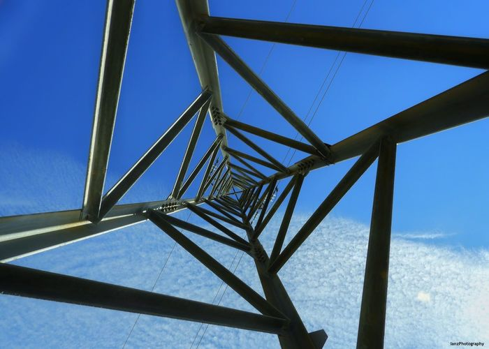 Pylon Looking Up Abstract Pylons And Power Lines Pylon Steelwork Metalwork Blue Sky Low Angle View Day No People Built Structure Outdoors
