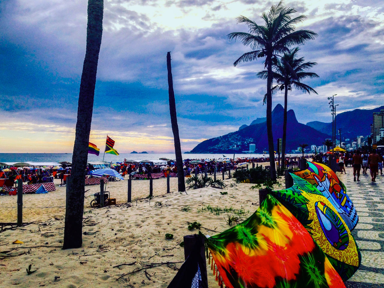 beach, sky, cloud - sky, sea, multi colored, sand, nature, outdoors, large group of people, water, real people, day, scenics, beauty in nature, tree, people