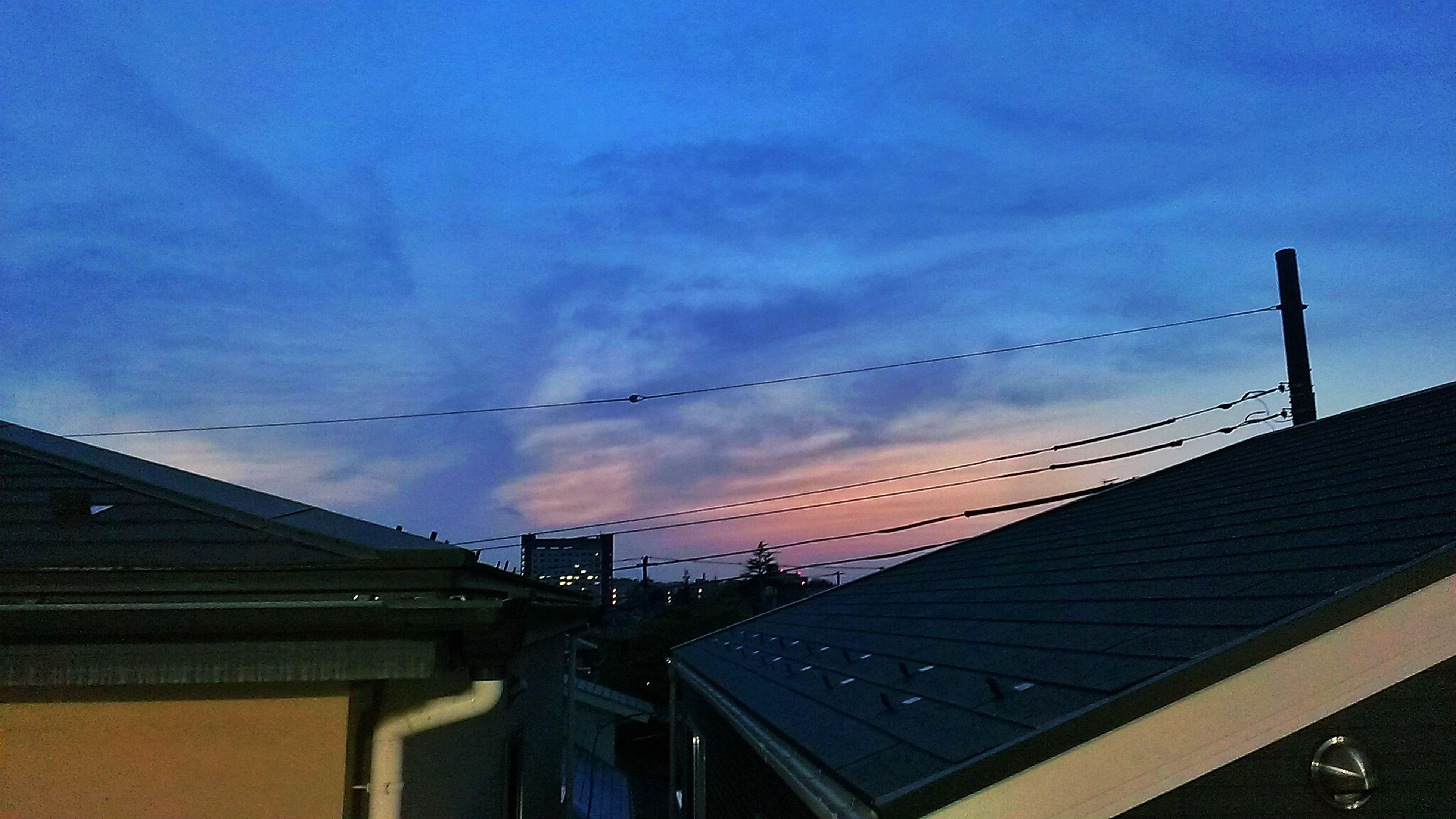 low angle view, sky, built structure, architecture, sunset, cloud - sky, connection, building exterior, silhouette, cloud, blue, railing, dusk, cloudy, outdoors, no people, bridge - man made structure, cable, nature, orange color
