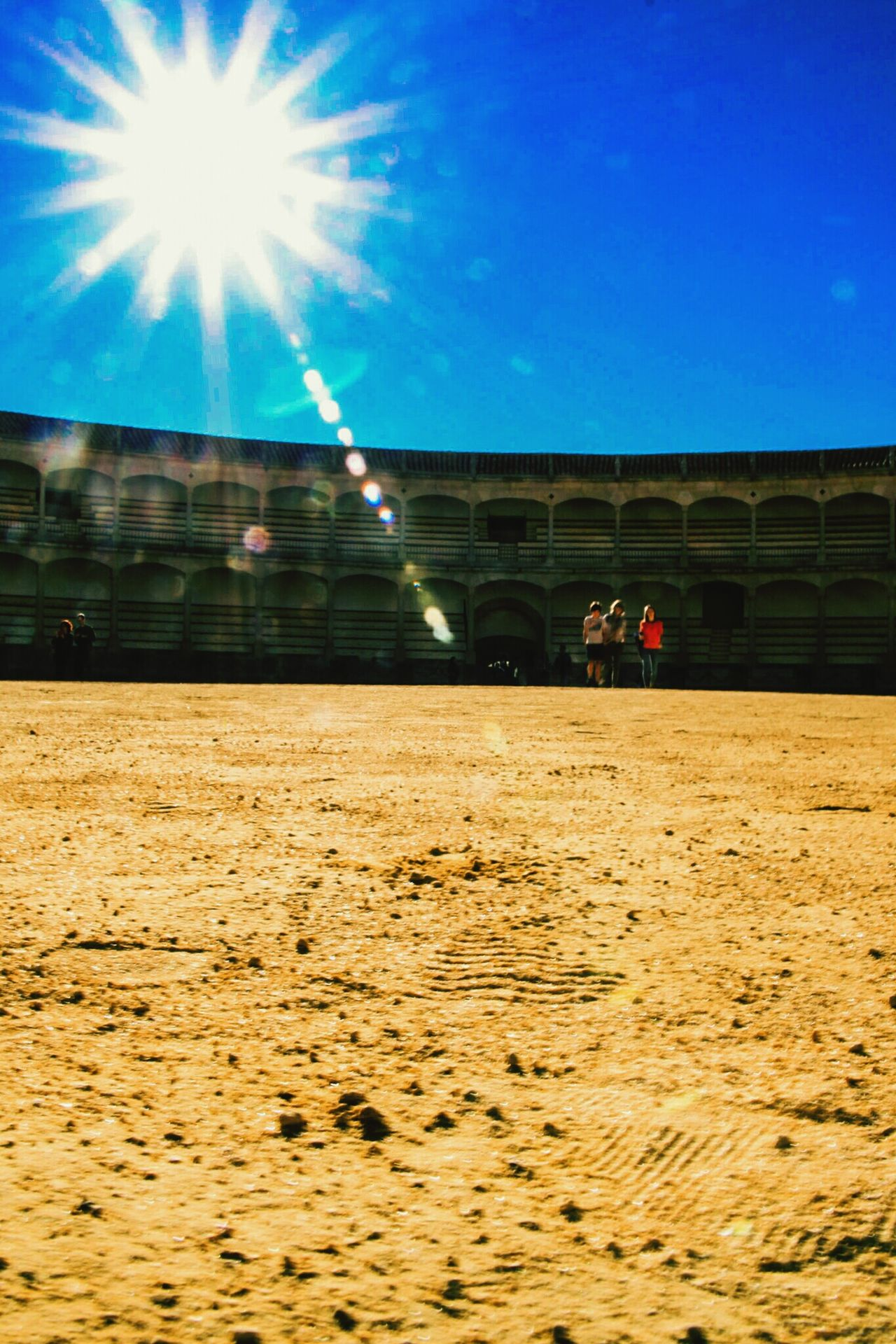 Sunlight Sky Outdoors Sunbeam Architecture Building Exterior Sun Men People Stadium Plaza De Toros Plazadetoros Ronda Ronda, Malaga Ronda Spain EyeEm Gallery Check This Out Low Angle View Arena Footprints Star Focus On Foreground