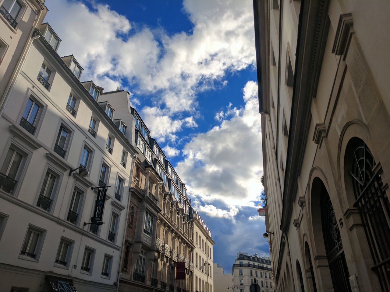 The Street Photographer - 2017 EyeEm Awards Cloud - Sky Low Angle View Sky Building Exterior Architecture Sunlight City Blue Paris Sky And Clouds High Contrast Windows Sunny Day