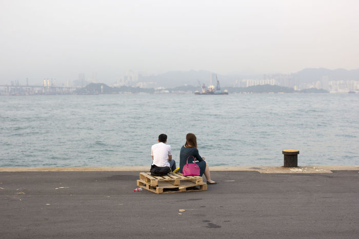 Admiring The View Asians China Chinese Couple Couples❤❤❤ Harbour Hong Kong Hong Kong Harbour Instagram Pier Love Ocean People Person Pier Sitting Street Photography The Street Photographer - 2016 EyeEm Awards