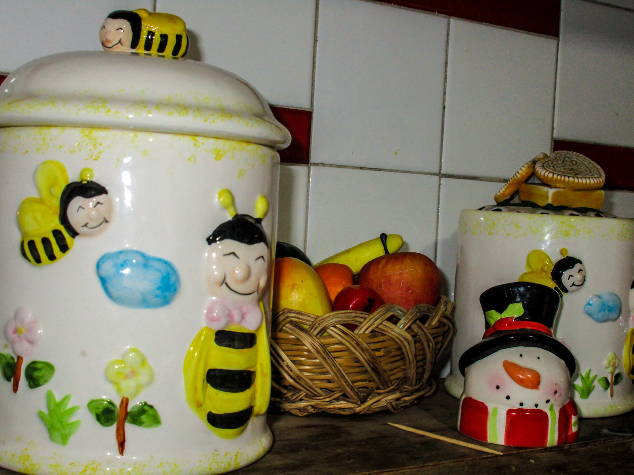 Apple Art And Craft Banana Bees Bees And Flowers Canister Ceramic Close-up Creativity Flowers Fruits Gastronomy Indoors  Jack O Lantern Jars  Kitchen Multi Colored No People Objects Ornaments Peach Red Sunflowers Wall Wood