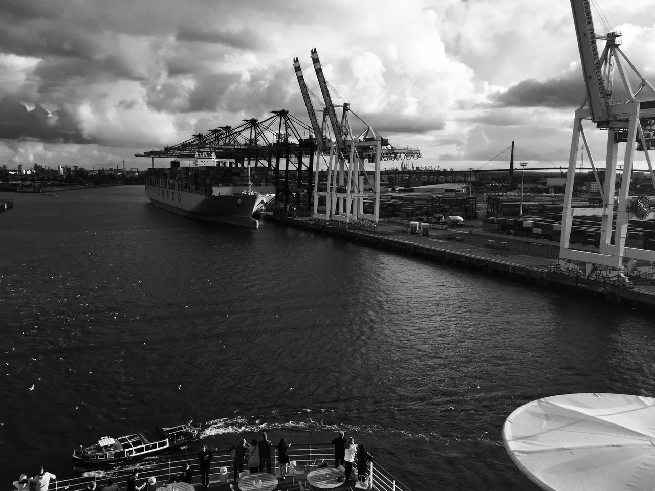 sky, cloud - sky, transportation, nautical vessel, harbor, built structure, crane - construction machinery, water, commercial dock, architecture, outdoors, shipping, freight transportation, day, no people, industry, building exterior, sea, city, shipyard