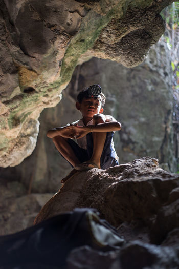 Cambodia Beauty In Nature Cambodian Children Casual Clothing Child Childhood Climbing Day Elementary Age Full Length Leisure Activity Lifestyles Nature One Person Outdoor Photography Outdoors Real People Rock - Object Rock Climbing Sitting Tree Water Wild Young Adult Young Women