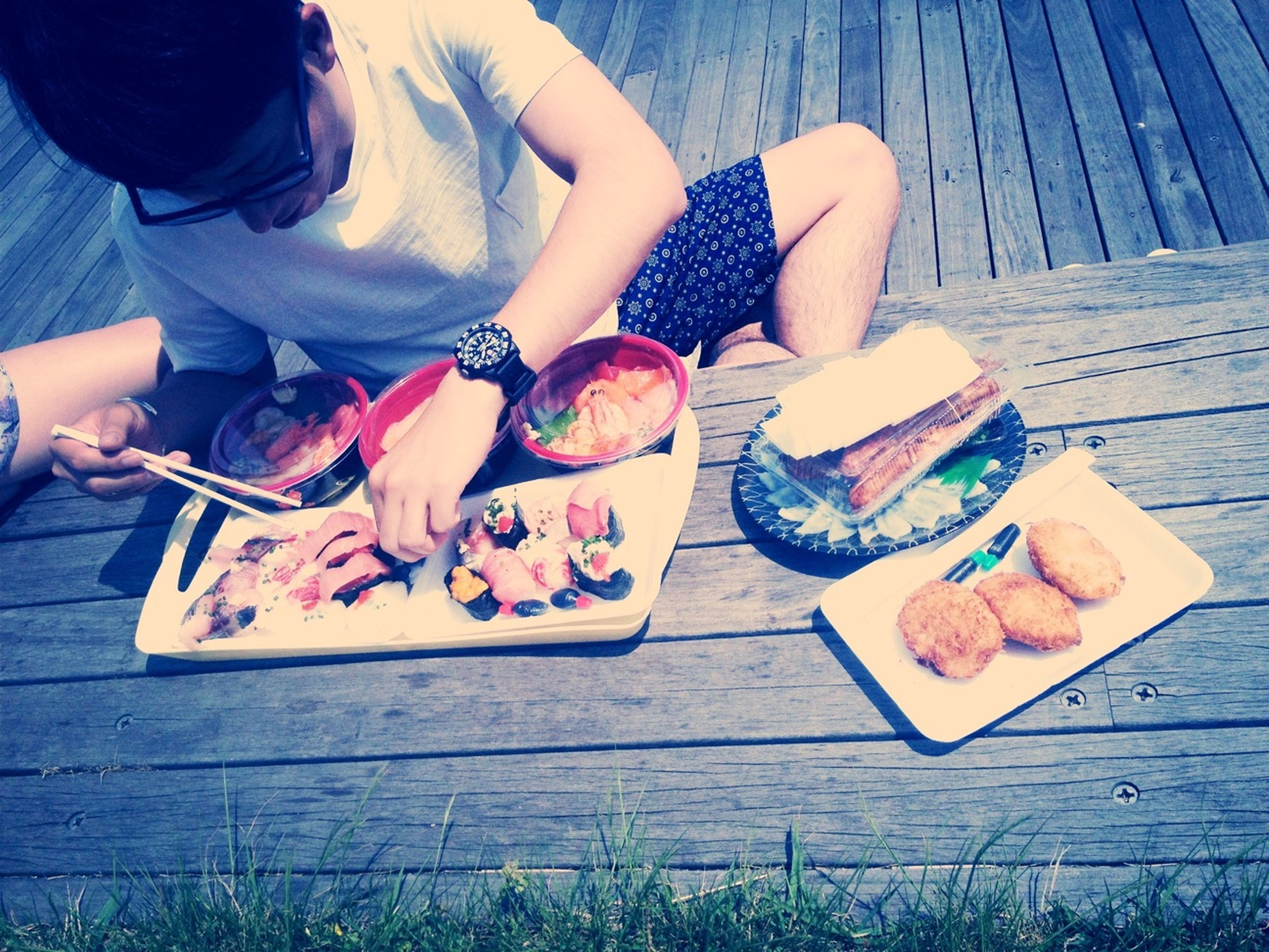 food and drink, lifestyles, table, leisure activity, person, food, high angle view, freshness, wood - material, sitting, love, togetherness, day, friendship, standing, holding, bonding
