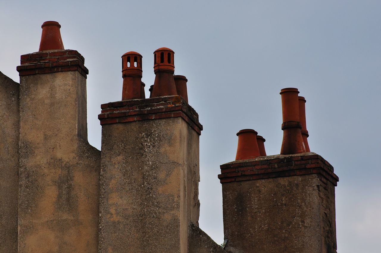 Architecture Burgundy Chimney Tops Day Local Specialty No People Outdoors Rooftop Sky Typical