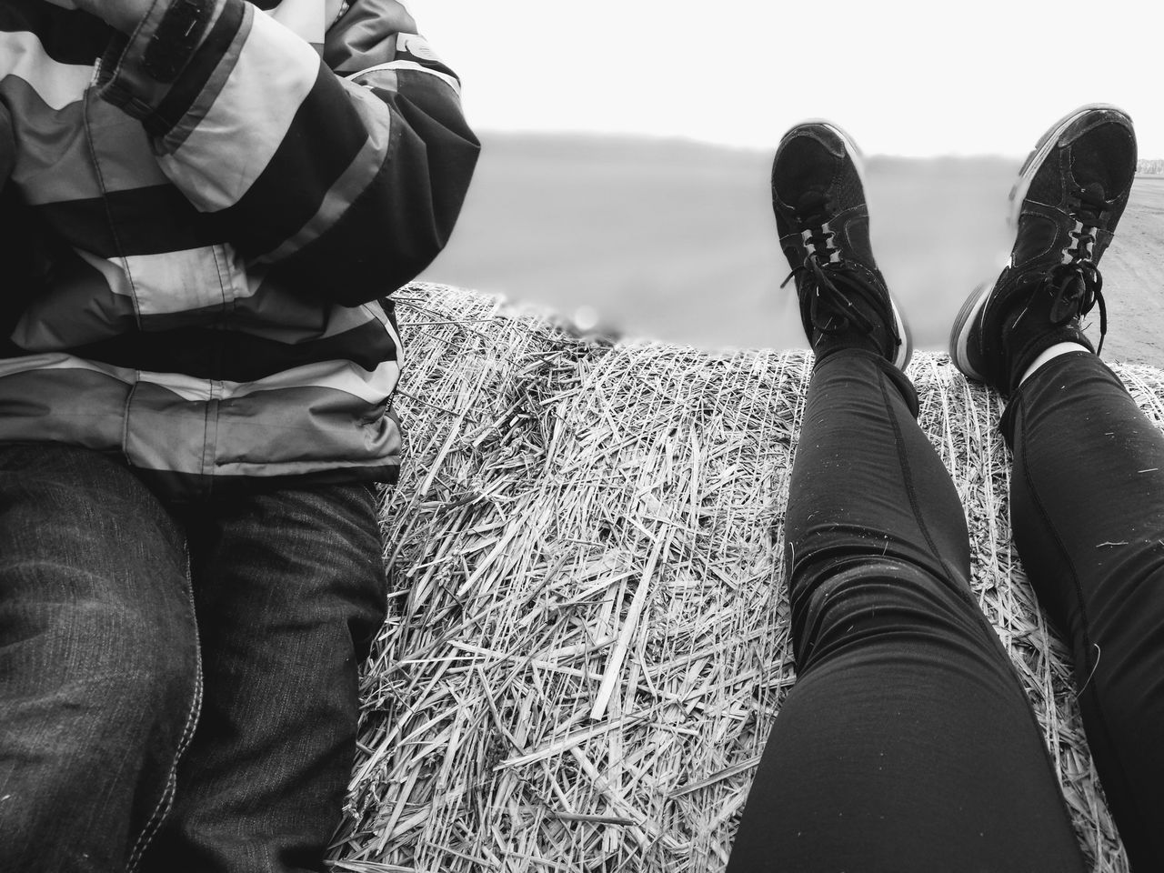 Having a rest in black & white. Straw Bale Special Moment Family Time Childhood Memories Nature Day Outdoors Landscape Beauty In Nature People Agriculture Agricultural Land Field Rural Scene Quality Time Togetherness EyeEm Diversity The Secret Spaces Having A Rest Having A Good Time Cropped Body My Unique Style Natures Diversities Human Body Part Art Is Everywhere TCPM The Great Outdoors - 2017 EyeEm Awards BYOPaper! Live For The Story