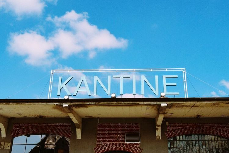 Kantine club III ravensburg, germany Architecture Built Structure Building Exterior Low Angle View Blue Sky City Day High Section Façade Cloud Outdoors Commercial Sign No People City Life Town Ravensburg Architecture Germany Disco Club