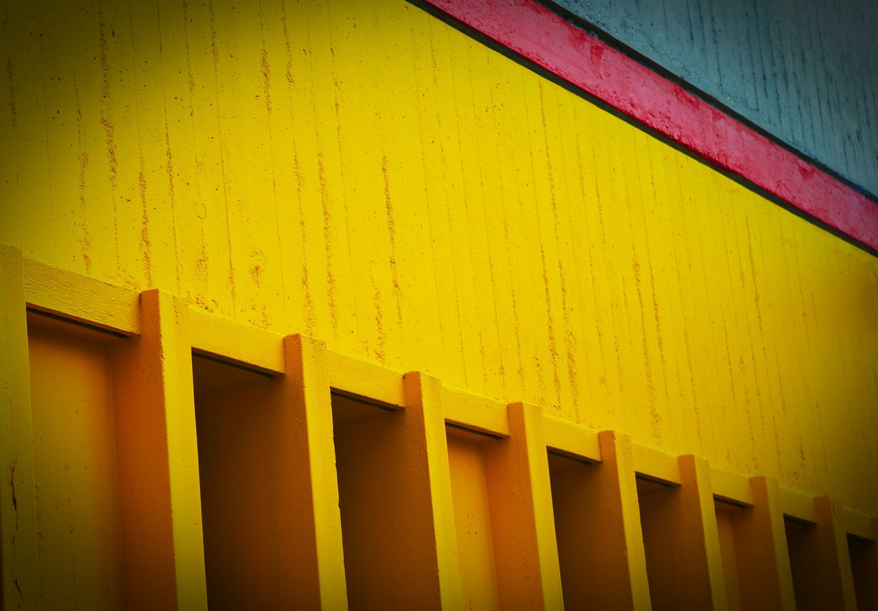 yellow, in a row, no people, wood - material, indoors, architecture, built structure, close-up, day