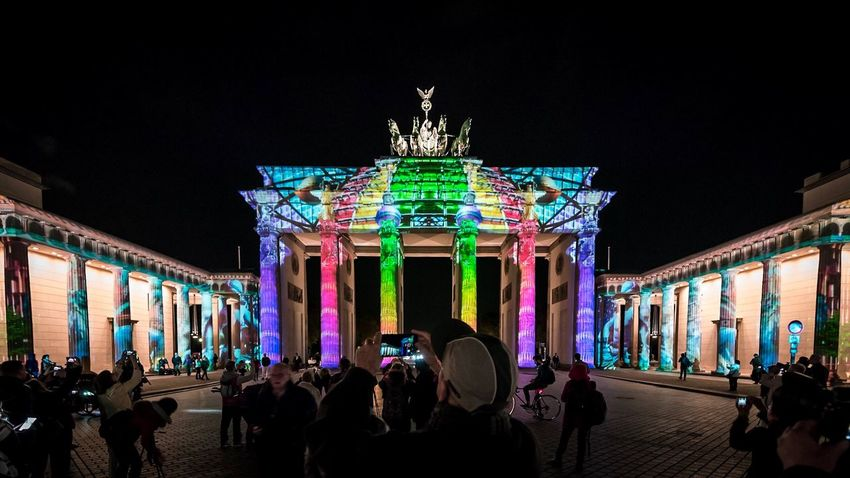 Night Illuminated Large Group Of People Architecture Built Structure City Gate Crowd Building Exterior Real People Travel Destinations Outdoors Nightlife People Adult Adults Only